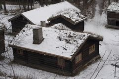 Old wooden farm houses in winter. Ethnic park in Oslo - capital of Norway Stock Photography