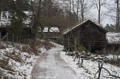 Old wooden farm houses in winter. Ethnic village in Oslo Royalty Free Stock Image