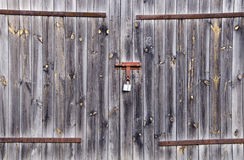 Old wooden farm rural building door locked padlock Royalty Free Stock Photo