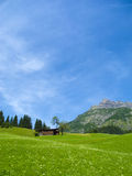 Old wooden farmhouse in the mountains Stock Image