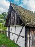 Old wooden farmstead. With typical timber framing, part of heritage park in Kluki, Poland Royalty Free Stock Photos