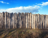 Old wooden fence against blue sky with clouds. Background Royalty Free Stock Photography