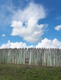 Old wooden fence against blue sky with clouds. Background Royalty Free Stock Photos
