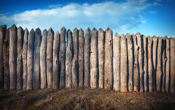 Old wooden fence against blue sky with clouds. Background Stock Photography