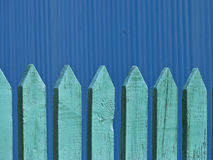 Old wooden fence, background. Old wooden fence as a background, in white blue color, against blue background Stock Photography