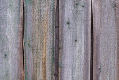 Old wooden fence background. Close up of old weathered planked background Stock Images