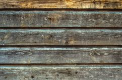 Old wooden fence background texture. Aged rough rustic horizontal planks as a wall or floor background texture Stock Image