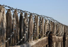 Old wooden fence with barbed wire perspective Stock Photos