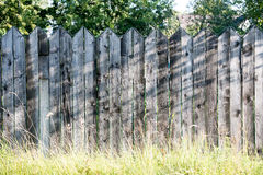 Old wooden fence. With barbed wire on top Royalty Free Stock Photo