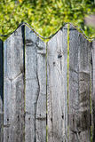 Old wooden fence. With barbed wire on top Royalty Free Stock Photography