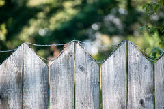 Old wooden fence. With barbed wire on top Royalty Free Stock Photos