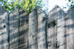 Old wooden fence. With barbed wire on top Royalty Free Stock Images