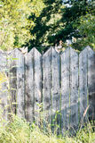 Old wooden fence. With barbed wire on top Stock Photography