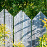 Old wooden fence with barbed wire on top. Square image Royalty Free Stock Photos