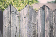 Old wooden fence with barbed wire on top. Vintage. Royalty Free Stock Images