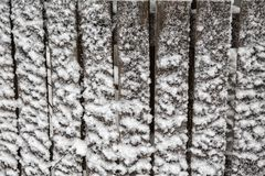 Old wooden fence board with snow. Old wooden fence board covered with snow Royalty Free Stock Photography