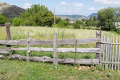 Old wooden fence in the countryside. Gray wooden rustic fence Royalty Free Stock Image