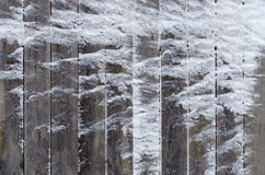 Old wooden fence, covered with snow Royalty Free Stock Photo