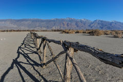 Old wooden fence in desert by mountains Royalty Free Stock Images