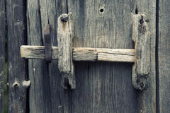 Old wooden fence with door handle. Closeup of old wooden fence with door handle Stock Photo