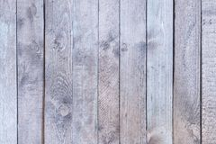 Old wooden fence with faded light gray wood. Smooth vertical boards. Blank background. stock photography