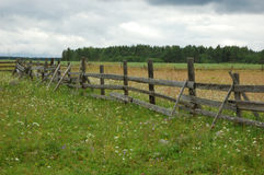 Old wooden fence in the field Stock Images