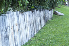 Old wooden fence in garden Royalty Free Stock Photography