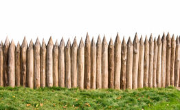 Old wooden fence and grass. Ancient stockade isolated with clipping path Royalty Free Stock Photography