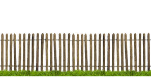 Old wooden fence isolated. Old wooden fence and green grass isolated on white Royalty Free Stock Photography