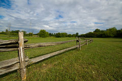 Old wooden fence in meadow. A wide angle landscape of old wooden fence and grassland in Upper Canada Migratory Bird Sanctuary Ontario Royalty Free Stock Photography