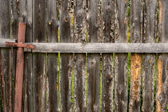 Old wooden fence with metal pipe  background Stock Image