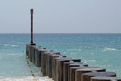 Old wooden fence near the beach, partly blurred Stock Photography