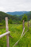 Old wooden fence near the railroad in the Carpathians Stock Photography