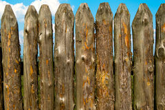 Old wooden fence over the sky and clouds Royalty Free Stock Image