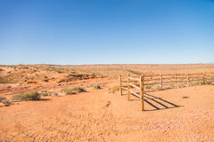 Old wooden fence in the sandy desert Royalty Free Stock Photography