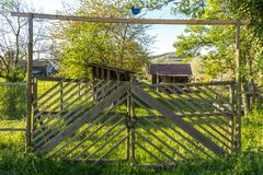 Old wooden fence securing a garden with a lock stock image