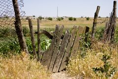Old wooden fence on the thrown farm Stock Photography