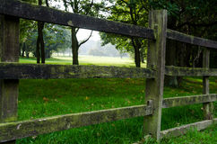 Old wooden fence. To a field of golf Stock Photography