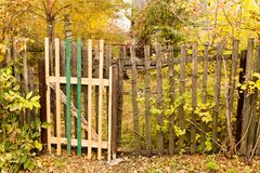 Old wooden fence in the village in autumn.  Royalty Free Stock Photography