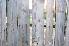 Old wooden fence in the village near house Royalty Free Stock Image