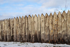 Old wooden fence in the village, winter time Stock Photography