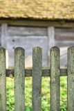 Old wooden fence, wooden wall of barn on background, copy space. Life in the village, Western Ukraine stock photos