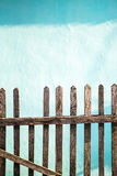 Old wooden fence, the wall whitewashed by lime in sea wave color on background, copy space Royalty Free Stock Photography