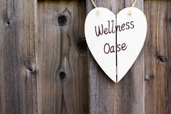 Wooden fence and wellness signboard Royalty Free Stock Photo