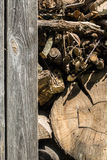 Old wooden fence and wood. Old wooden fence and the wood, excellent wooden background Royalty Free Stock Photo