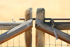 An old wooden fence. A wood fence held together with a clothes pin with gauge wire and a blurred background Stock Image