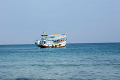Old wooden ferry boat brings tourists to the small island of Koh Royalty Free Stock Images