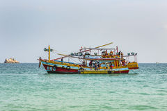 Old wooden ferry boat brings tourists to the small island of Koh Royalty Free Stock Photography