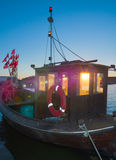 Old wooden fishermen boat on island Rugen, Northern Germany royalty free stock photos