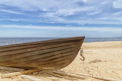 Old wooden fishing boat on beach Royalty Free Stock Image